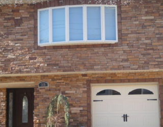 decorative residential house front with cultured stone