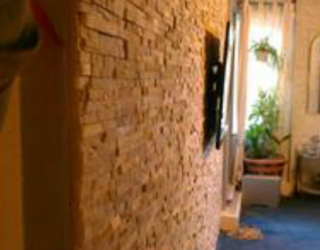 decorative cultured stone wall inside residential home