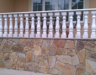 flag stone culture stone wall with railings