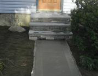 concrete walkway and stone stairway residential