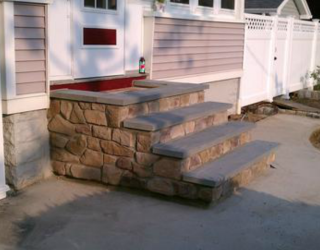 culture stone stairway outside of residential home