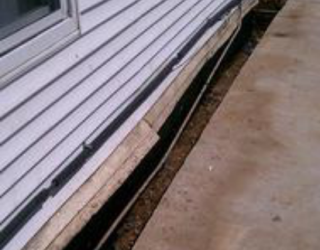 foundation repair on side of residential home