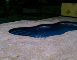 stampcrete pavers surrounding a pool by tonys masonry