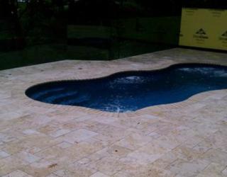 stampcrete pavers surrounding a pool by tonys masonry