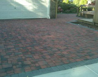 red and black pavers with solid black pavers trim driveway masonry by tonys masonry