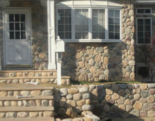 cobble stone house front , walls, and stairway