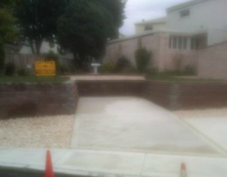 driveway with brick wall lining