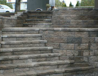 stone stairway installed outside residential home
