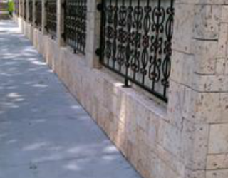 stone fence outside of residential home