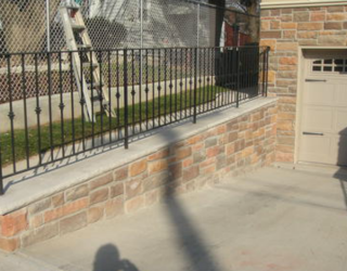 driveway stone wall unit installed by pavers