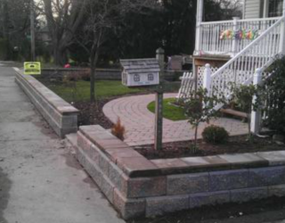 stone wall lining outside residential home