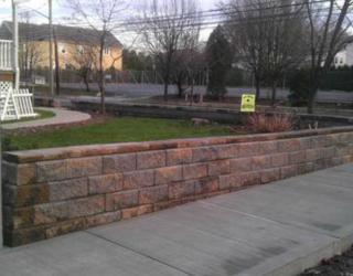brick wall lining sidewalk