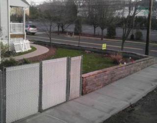 residential sidewalk with brick wall lining