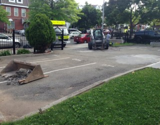 the beginning phase of repairing a parking lot