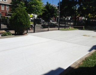 new concrete parking lot paved by pavers