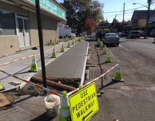 sidewalk newly paved by pavers near storefront