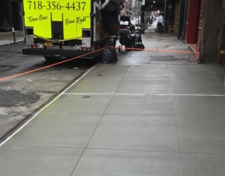new city sidewalk paved by pavers
