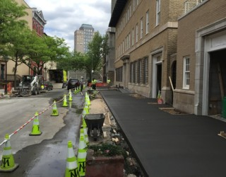 new sidewalk being paved near commercial building