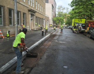 pavers paving asphalt on city street
