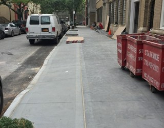 driveway and sidewalk installed by commercial building