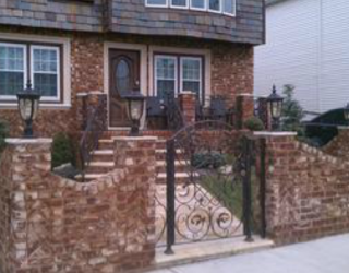 decorative fencing and walkway installed by pavers