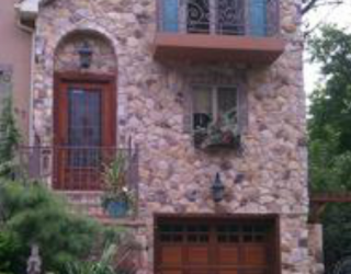 Cultured stone house front installed by pavers