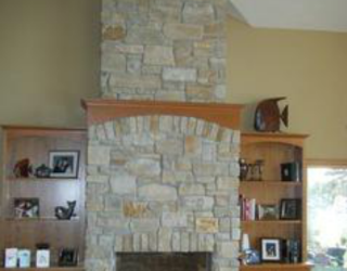 cultured stone designed custom fireplace
