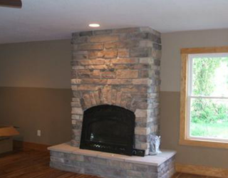 culture stone fireplace designed and installed by pavers