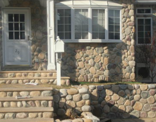 cultured stone installed by pavers on house