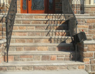 cultured stone stairway in front of house installed by pavers
