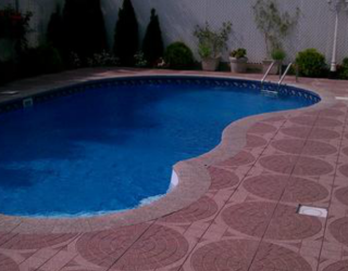 stampcrete installed by pavers around pool