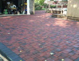 Backyard with brick flooring installed by pavers
