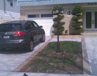 cement driveway and walkway paved by pavers
