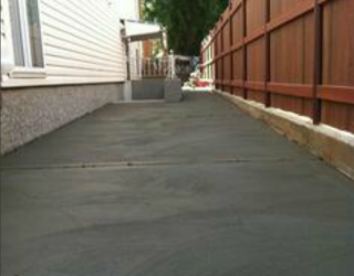 cement driveway paved by pavers